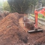 Planting rhododendrons : digging the trench around the garden border.