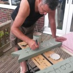 Mike making and painting the Forest School signs